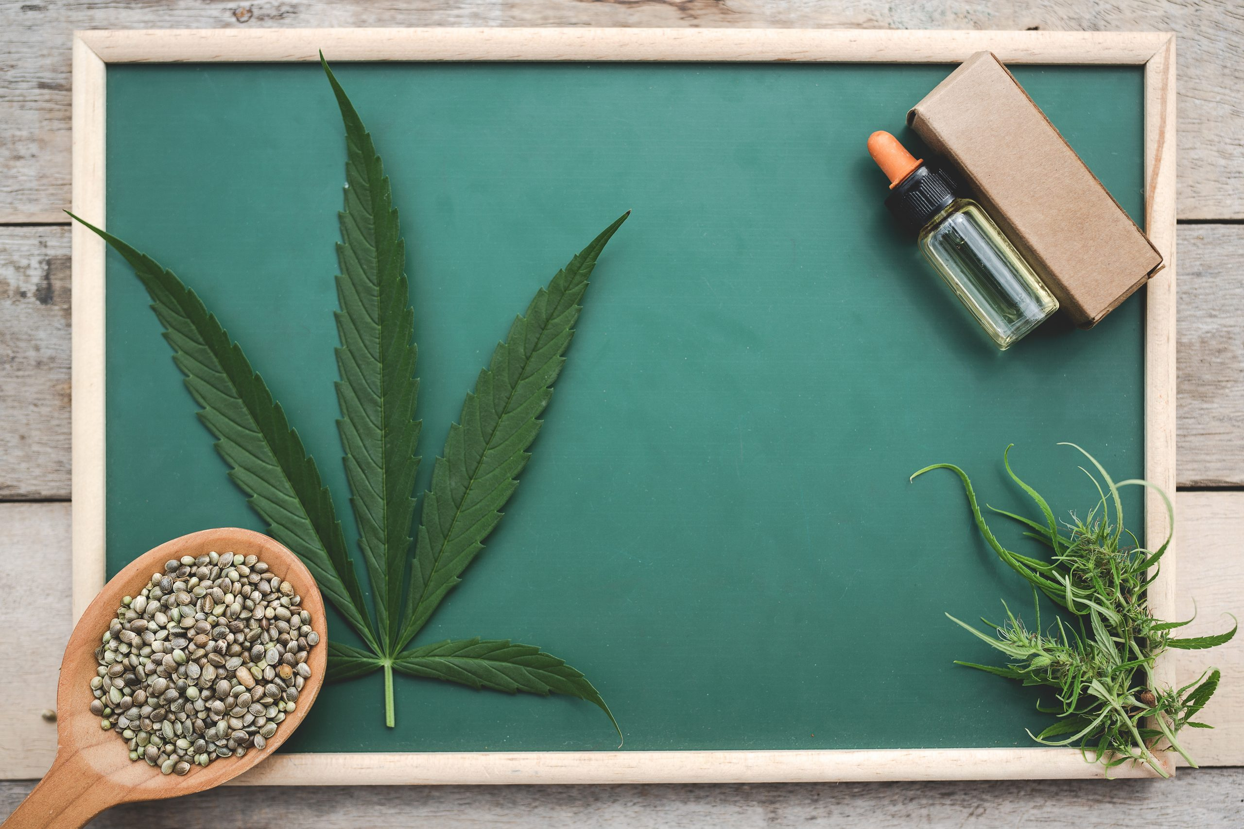 Cannabis oil Placed on a green board on a wooden